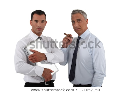 Boss holding cigar whilst employee does all the work Stock photo © photography33