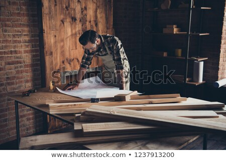 architect and a carpenter looking at plans stock photo © photography33