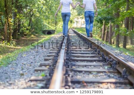 Permanente rail aantrekkelijk jonge vrouw koffer hemel Stockfoto © grafvision