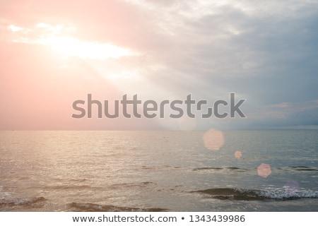 Sun ray over lake stock photo © samsem