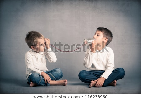 young child listening to tin can phone Stock photo © gewoldi
