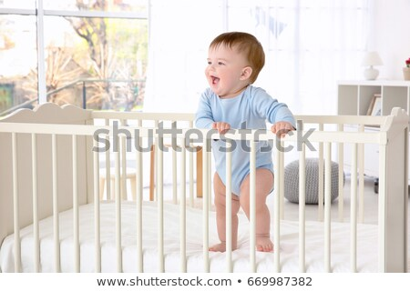 portrait of toddler standing in cot Stock photo © phbcz