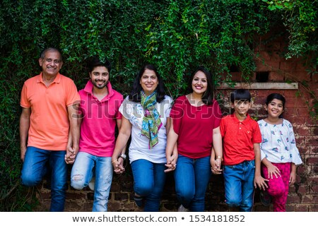 image of Portrait of a happy family standing in a line stock photo © get4net