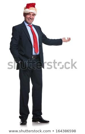 Egészalakos kép érett üzletember mikulás bemutat Stock fotó © feedough