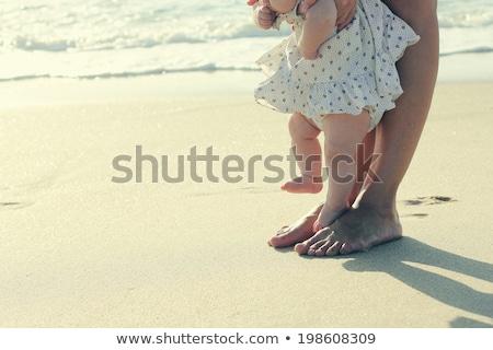 Baby and mother's feet on the beach Stock photo © dashapetrenko