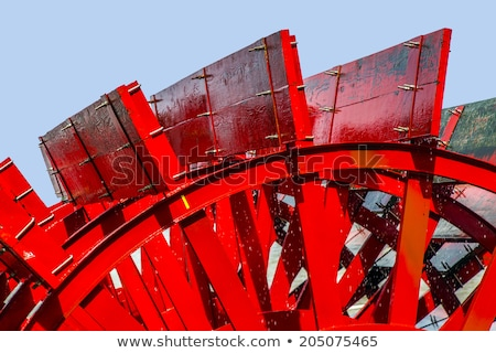 red riverboat paddle wheel in a river with trees stock photo © meinzahn