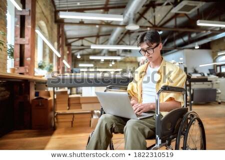 upośledzony · biznesmen · posiedzenia · wózek · portret · biuro - zdjęcia stock © tintin75