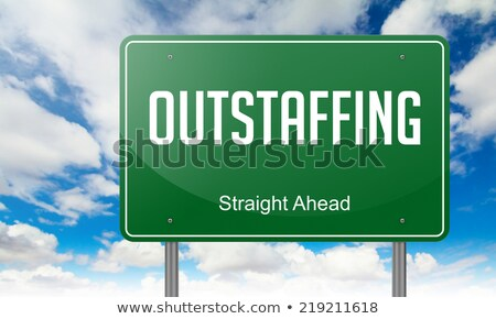Outstaffing on Green Highway Signpost. Stock photo © tashatuvango