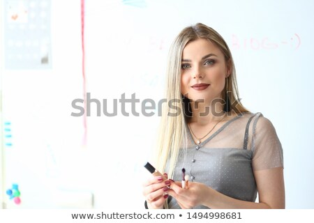 Blonde girl reviewing images on camera Stock photo © Hofmeester