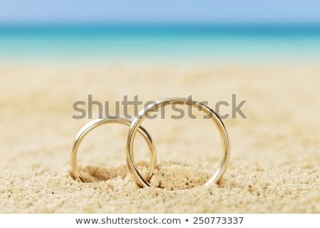 Stock photo: Wedding rings beach love concept