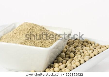 organic white pepper in ceramic bowl stock photo © ziprashantzi