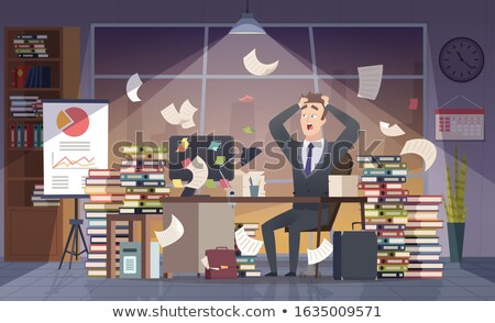 Businessman working overtime at office desk Stock photo © stevanovicigor