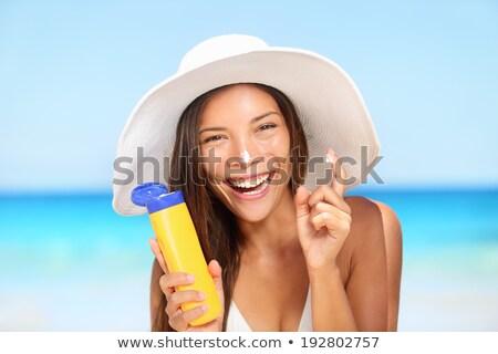 praia · biquíni · mulher · protetor · solar · férias · de · verão - foto stock © maridav