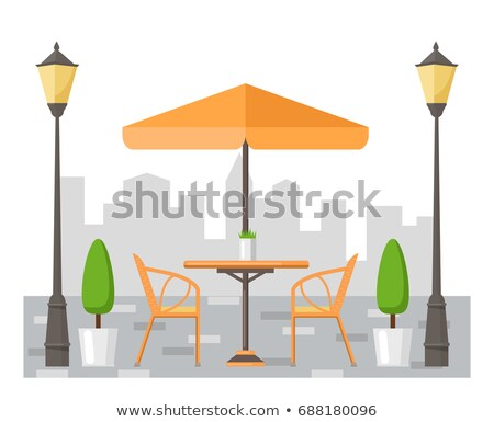 a table with an umbrella in a cafe stock photo © bluering