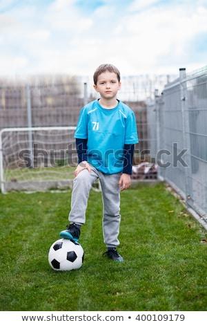 A boy wearing a green shirt Stock photo © bluering