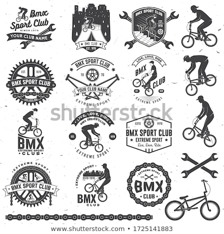 young cyclist jumping stock photo © orla