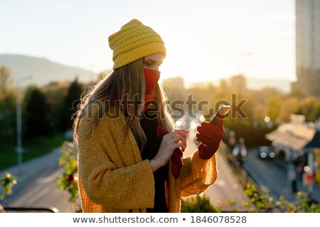 stern beautiful woman on the phone outdoors Stock photo © Giulio_Fornasar