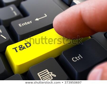 Finger Presses Yellow Keyboard Button T and D. Stock photo © tashatuvango