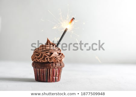Close-up of burning sparkler on decorated cupcakes Stock photo © wavebreak_media