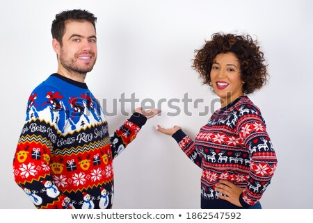 happy young casual couple welcoming you Stock photo © feedough