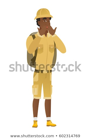 Shoked african-american traveler covering mouth. Stock photo © RAStudio