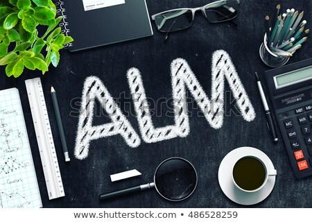 ALM Concept on Black Chalkboard. 3D Rendering. Stock photo © tashatuvango
