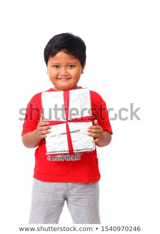 young boy holding box to camera Stock photo © IS2