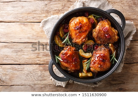 chicken thighs in a frying pan stock photo © ssuaphoto