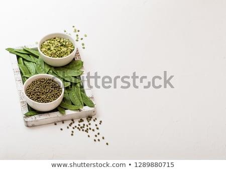Bowl of  mung beans and split peaswith raw organic mangetout in vintage wooden box on white stone ki Stock photo © DenisMArt