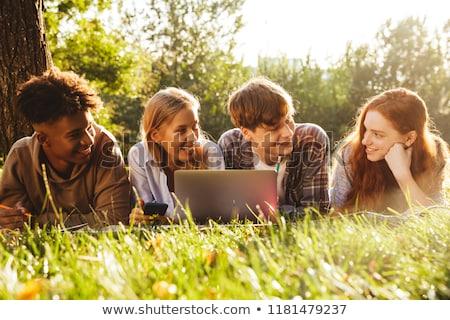 huiswerk · met · behulp · van · laptop · vergadering · vloer · computer - stockfoto © deandrobot