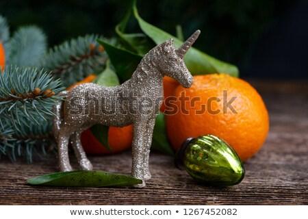 Unicorne with mandarines Stock photo © neirfy