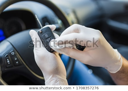 close up of hands with alcohol and car key Stock photo © dolgachov