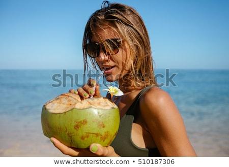 吸引力 · 年輕女子 · 飲用水 · 海灘 · 背面 · 飲料 - 商業照片 © galitskaya