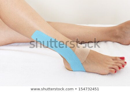 Woman With Physio Tape On Her Shoulder Stock photo © AndreyPopov