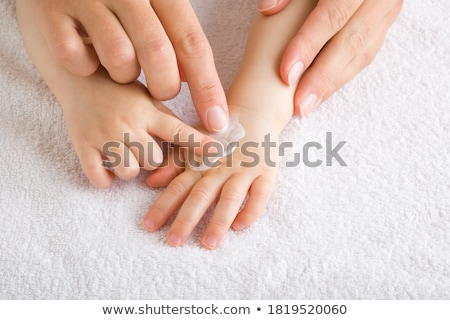 Close up of a beautiful young girl with towel Stock photo © deandrobot