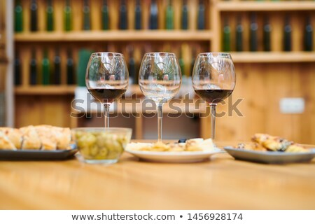 Row of wineglasses with red wine and snacks near by prepared for sommelier Stock photo © pressmaster
