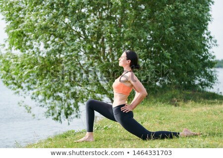 Low lunge pose with hands on hips Stock photo © pressmaster