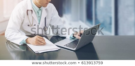 Male Doctor Working On Computer Stock photo © AndreyPopov