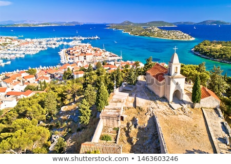Stock photo: Dalmatian town of Tribunj church on hill and amazing turquoise a