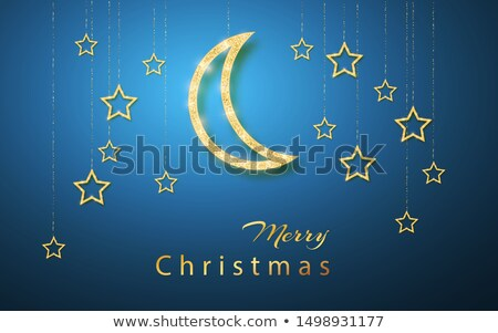 Merry Christmas. Gold handing shiny glitter glowing star isolated on blue night background. Vector i Stock photo © olehsvetiukha