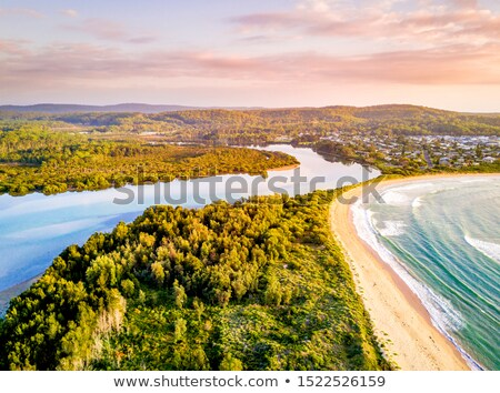 early morning light over coastal beaches and river stock photo © lovleah
