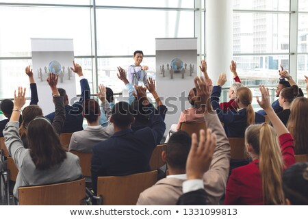 Сток-фото: Rear View Of Diverse Business People Raising Hands While They Are Sitting In Front Of Asian Business