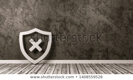 Shield Symbol with Cross on Wooden Floor Against Wall Stock photo © make