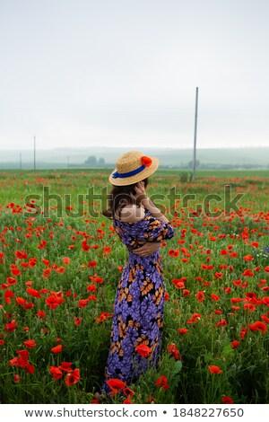 Kobieta wiejskie sceny łące dziedzinie maki kwiat Zdjęcia stock © ElenaBatkova