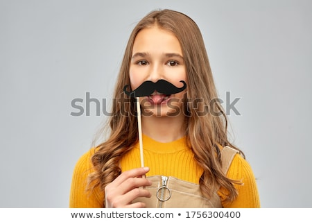 red haired teenage girl with black moustaches Stock photo © dolgachov