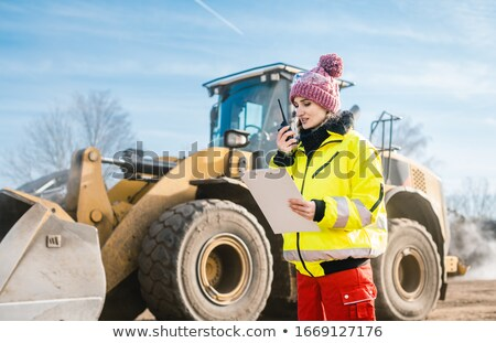 Woman with walkie talky on compost facility dispatching deliveries Stock photo © Kzenon