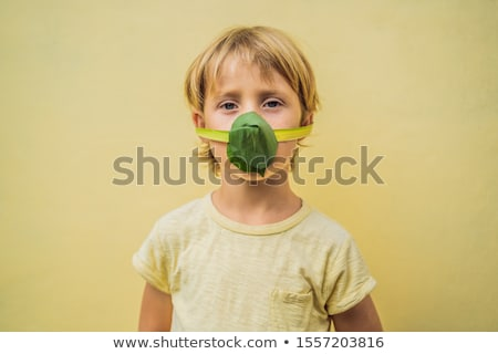 The child made himself a face mask from the leaves to protect himself from air pollution. Air purifi Stock photo © galitskaya