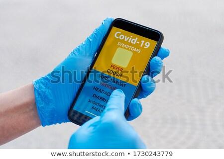 man checking some symptoms of the covid-19 Stock photo © nito