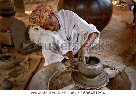 Indian potter at work. Handwork craft from Shilpagram, Udaipur, Rajasthan, India Stock photo © dmitry_rukhlenko