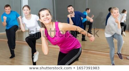 woman dancing or exercising Stock photo © godfer